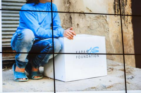 Girl sitting next to foundation titled box